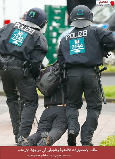 Police arrest an activist during a demonstration against Germany's anti-immigration party Alternative for Germany (AFD) before the AFD's party congress in Cologne